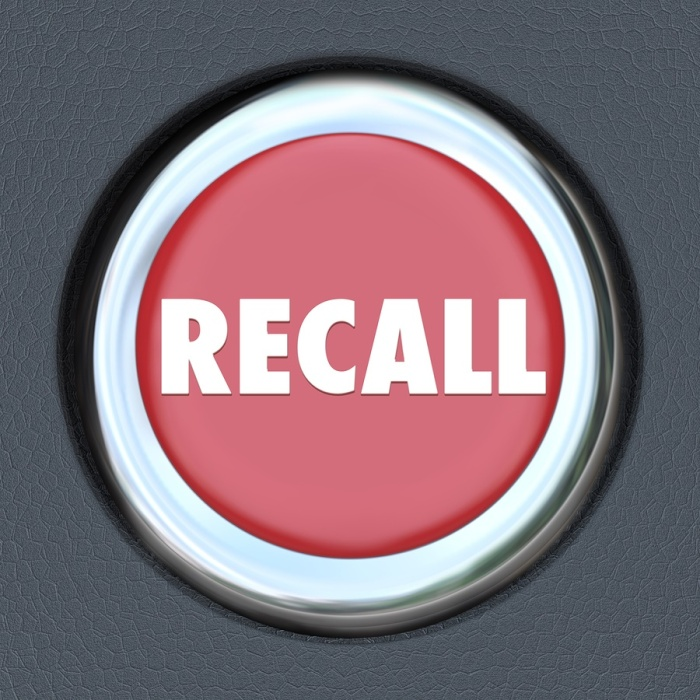 Recall word on a red round car or vehicle ignition button to ill